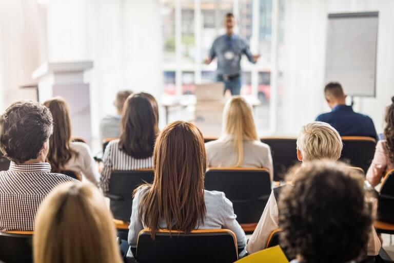 Business people attending seminar