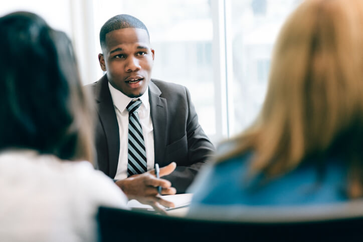 Financial advisor meeting with two businesswomen