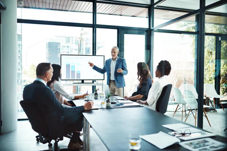 Businessman giving a presentation in a boardroom