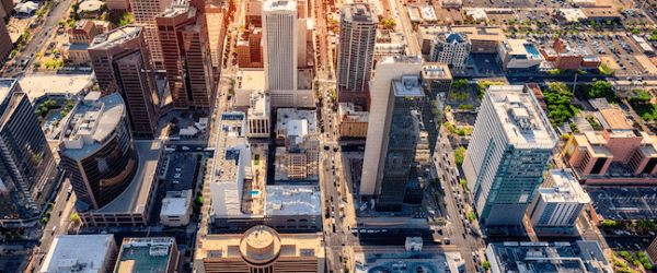 An aerial view of downtown Phoenix, Arizona and the surrounding urban area shot at dusk