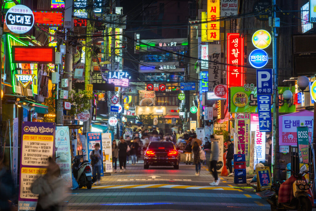 Seoul crowded streets of Sinchon nightlife neon signs South Korea